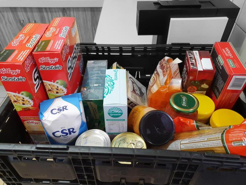 Donation to RFSCH Food Bank Glenda Coswello and Jasdip Singh
