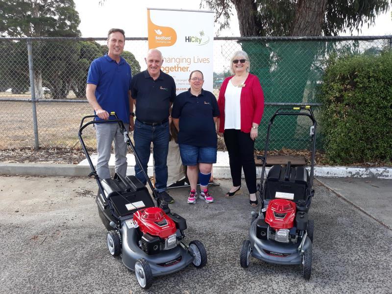 Glenda Coswello & Addrian Pilati with HiCity workers for mowers presentation4a