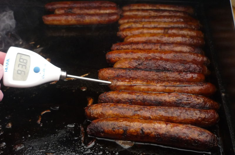 cooking sausages at rotary bbq